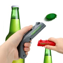 Cap gun - bottle opener - shoots the cap away